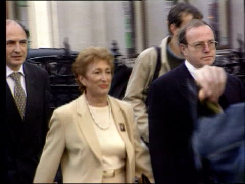 london ext former westminster council leader dame shirley porter along pan porter with press around porter into high court building - porter stock videos & royalty-free footage