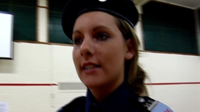 london ext general views and close shots of volunteer police cadets drill marching in hall goksan dede interview sot - cadet stock videos & royalty-free footage