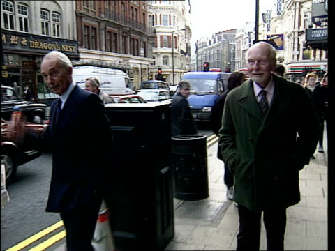 gielgud towards along street with companion martin hensler pull out as he stops to sign autograph - john gielgud stock videos & royalty-free footage