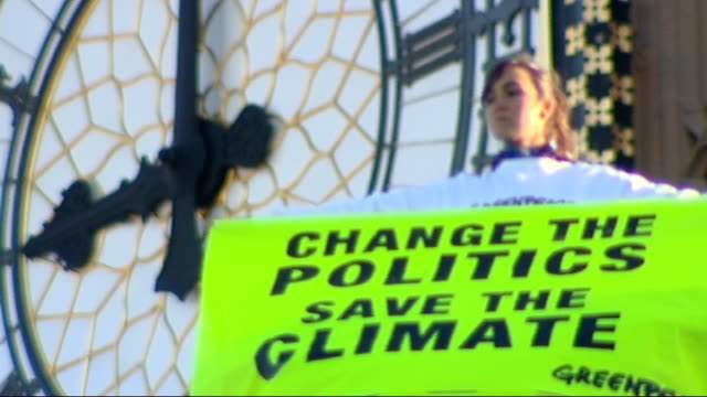 good general views of greenpeace climate change protestors on the roof of the house of commons - greenpeace stock videos & royalty-free footage