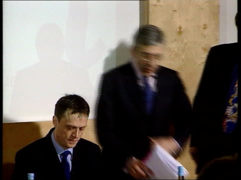 london ext home secretary jack straw mp along street past press and greeted pan to bv away into building straw along to take seat for press... - defendant stock videos & royalty-free footage