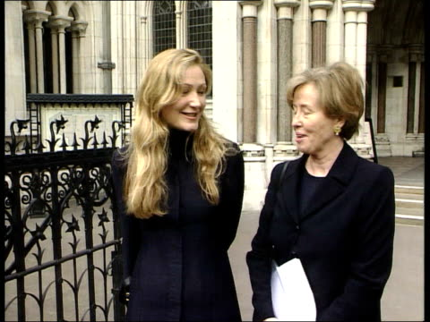 vídeos de stock, filmes e b-roll de london ext josephine rowland and daughter posing outside court side press rowland and daughter away towards court - widow