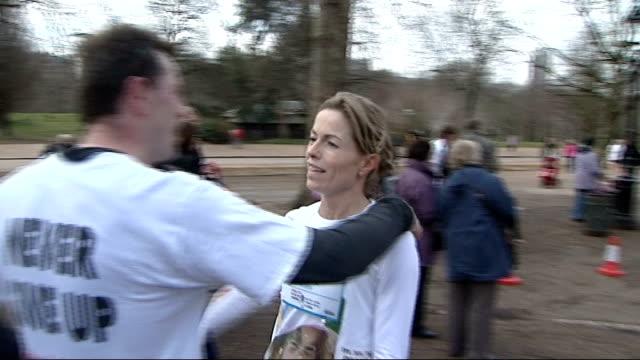 stockvideo's en b-roll-footage met kate mccann running along then embracing her husband gerry mccann - itv weekend evening news