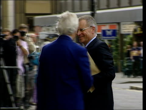london lord archer arriving at the old bailey for perjury trial pan as shakes hands with man and in car of archer pulling away ted francis... - day 2 stock videos & royalty-free footage