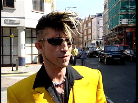 london: ext martin degville and taylor along road martin degville interview sot - that hairstyle has been around for long time/ i used to have it... - sputnik stock videos & royalty-free footage