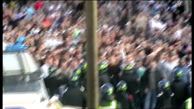 london ext mounted police officers keeping back west ham united supporters massed outside the ground before their match v millwall west ham and... - west ham fc stock-videos und b-roll-filmmaterial