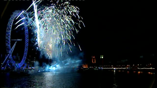 stockvideo's en b-roll-footage met london ext / night big ben striking midnight on new year's eve fireworks display over millennium wheel and river thames night ends - 2010
