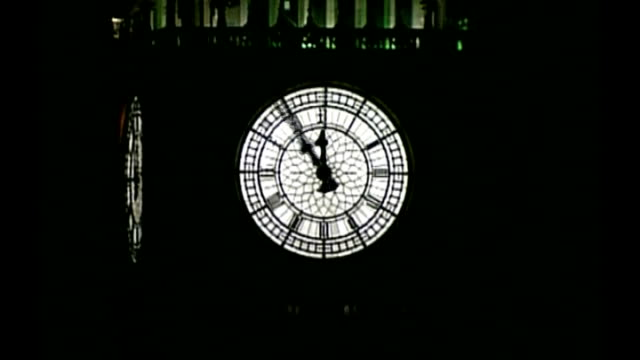 stockvideo's en b-roll-footage met ext / night graphiciseds sequence big ben striking midnight on new year's eve then speeded up sequence big ben winding backwards night - 2010