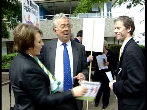 london norwich city owner delia smith down from coach and handed placard outside offices of itv companies carlton and granada to protest about... - delia smith stock videos and b-roll footage