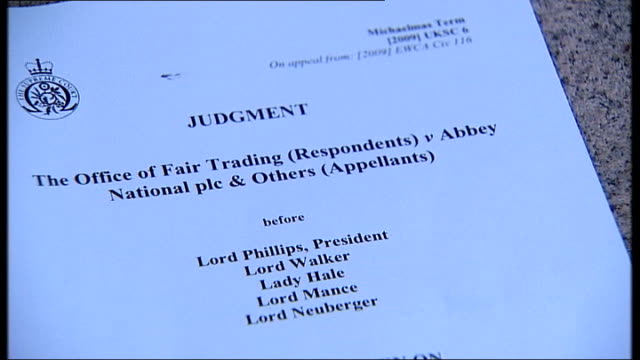 pages of judgement document in 'the office of fair trading vs. abbey national plc and others' case being flicked through reporter and mark gander... - plc stock videos & royalty-free footage