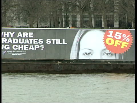 london: ext poster on barge in river with slogan 'why are women graduates still going cheap?' julie mellor interview sot - talks of need for... - equal opportunities stock videos & royalty-free footage