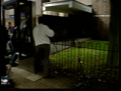 london press gathered outside flats where former conservative mp neil hamilton and his wife christine live press seen reflected in window copy of the... - christine last stock-videos und b-roll-filmmaterial