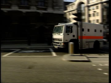 london: ext prison van bringing kenneth noye to court for trial for murder of stephen cameron to bv away into court building - kenneth noye stock videos & royalty-free footage