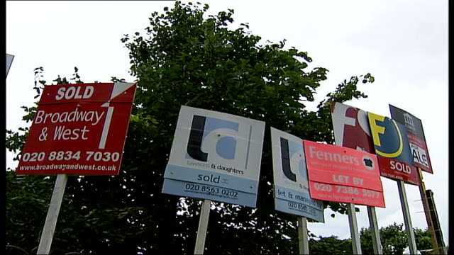 london ext row of houses in residential area various of 'sold' and 'for sale' signs 'to let' sign outside house 'sold' sign mews house various of... - for sale englischer satz stock-videos und b-roll-filmmaterial
