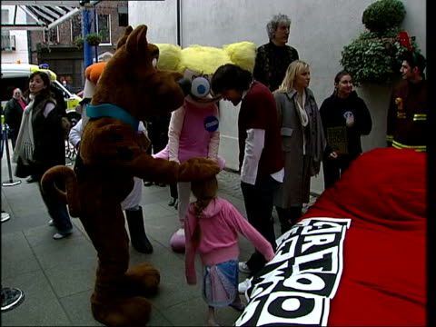 london presents being passed from hand to hand to fill the worlds largest christmas stocking sequence firemen carrying stocking along towards great... - natasha bedingfield stock videos & royalty-free footage