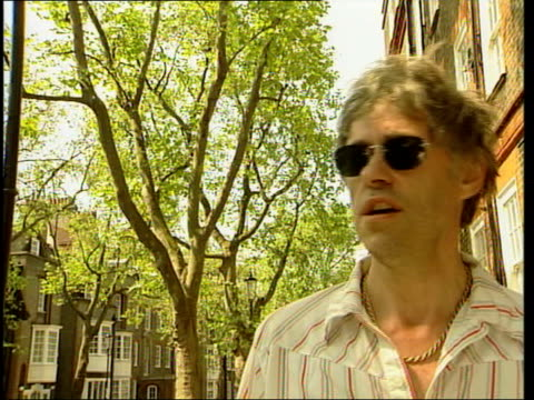 london sir bob geldof interviewed sot dylan crossed into literature into iconography into poetry into lyricism and into melody and into music and... - bob geldof stock videos & royalty-free footage