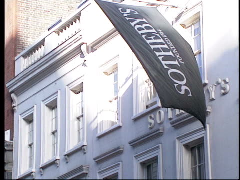 london sothebys auction house men carrying chair away from auction house - auction stock videos & royalty-free footage
