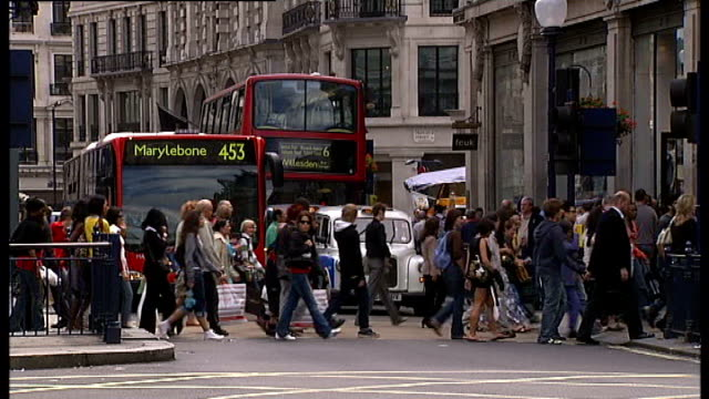 london lapse footage of people along at oxford circus traffic junction with regent street - oxford circus stock videos and b-roll footage