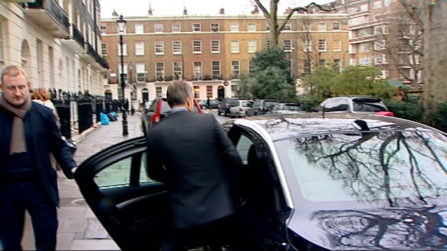 London EXT Tony Blair down steps then into car not answering as journalist heard saying 'Mr Blair your reaction to the interview' SOT