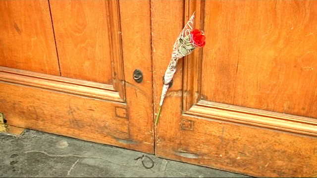 London EXT Tributes from fans for dead singer Michael Jackson including drawings and flowers outside the Lyric Theatre where musical 'Thriller Live'...