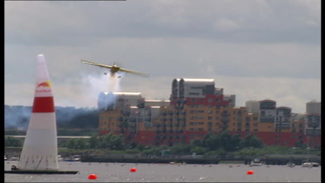 London EXT Various of light aircraft racing around obstacles along River Thames during Red Bull Race qualifying rounds