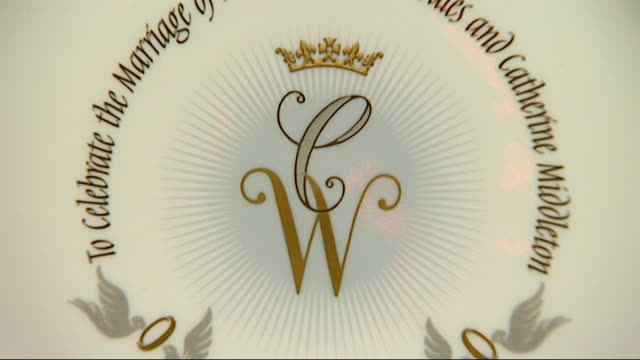 EXT Vox pops Close shot of design on official royal wedding china showing initials of Prince William and Catherine Middleton and Prince Williams's...