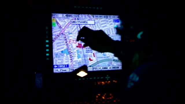 police helicopter rising after take off int back view police helicopter crew member looking at map on display screen view of london through window of... - surrounding stock videos & royalty-free footage