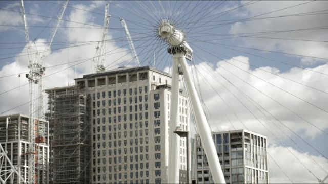 london eye and shell centre in redevelopment - millennium wheel stock videos & royalty-free footage