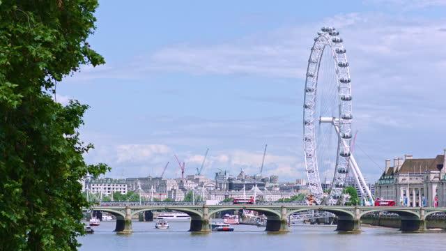 london eye (millennium wheel) and westminster bridge / london, england - double decker bus stock videos & royalty-free footage