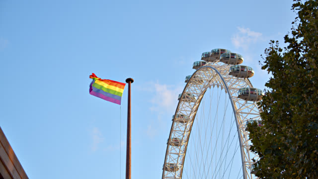 london eye ferris wheel. national landmark. rainbow flag - fashion show stock videos & royalty-free footage