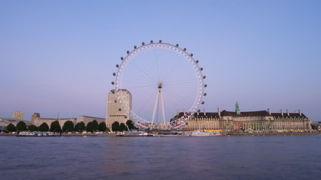 T/L London Eye from Embankment at dusk, with zoom in, London, England