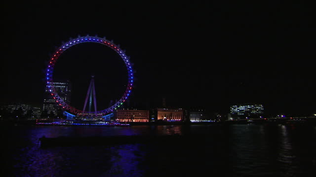 London Eye illuminated at night Available in HD
