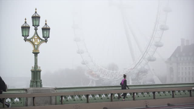 london eye, millennium wheel, and thames river surrounded by fog - flowing water stock videos & royalty-free footage