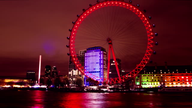 london eye, millennium wheel, uk, time lapse at night - millennium wheel stock videos & royalty-free footage