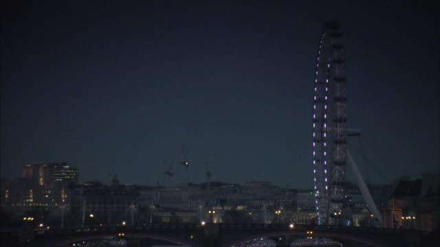 WS London eye with cityscape at night / London, UK