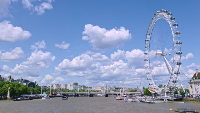 london eye (millennium wheel) with the river thames / london, england - cumulus stock videos & royalty-free footage