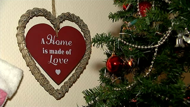 London families in temporary accomodation at Christmas Decoration on tree with the message A home is made of love