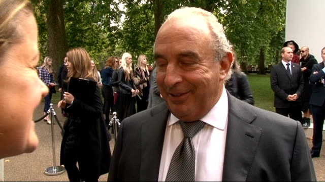 burberry spring/summer 2012 show interviews general views general view sir philip green speaking to other crew / sir ben kingsley along sir philip... - ben kingsley stock videos & royalty-free footage