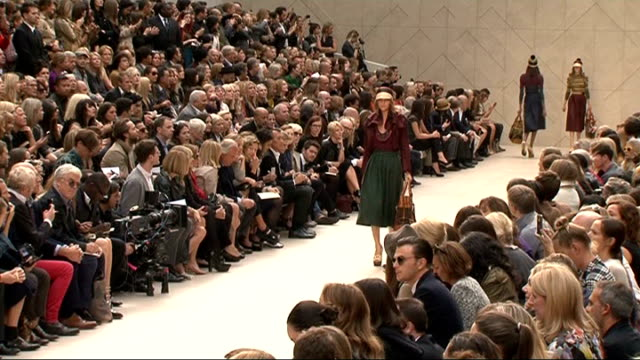 london fashion week 2011: burberry spring/summer 2012 show: interviews & general views; int wide shot burberry spring summer 2012 show, male and... - fashion show stock videos & royalty-free footage