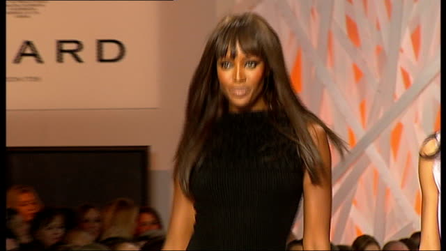 celebrity guests join models on catwalk england london throughout *** audience seated by side of catwalk naomi campbell along catwalk with... - naomi campbell stock videos & royalty-free footage