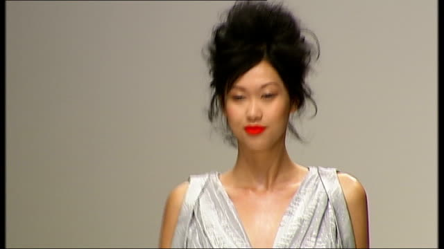 economic outlook int models along catwalk at fashion show - london fashion week stock videos and b-roll footage