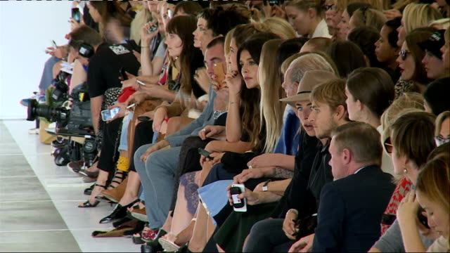 Topshop show **Music heard SOT** General views of models along catwalk during Topshop show includes Cara Delevingne and Lily Donaldson / front rows...