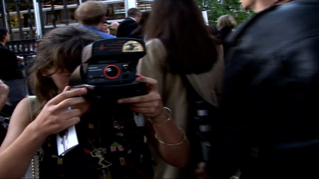visiting vips ext thom having her photograph taken outside venue - london fashion week stock videos and b-roll footage