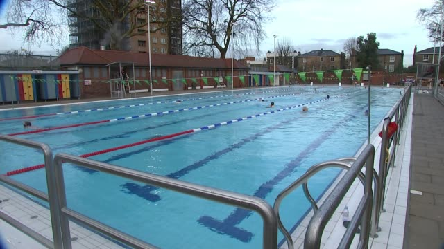 London Fields Lido reopens after major refurbishment ENGLAND London Hackney London Fields Lido EXT People swimming in outdoor swimming pool Swimmer...