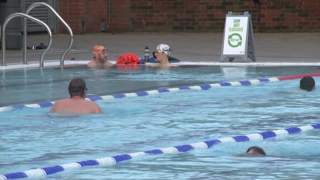 London Fields Lido reopens after major refurbishment ENGLAND London Hackney London Fields Lido EXT General views of people swimming in outdoor...