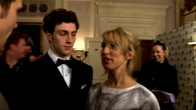 vídeos y material grabado en eventos de stock de london film critics' circle awards 2010 arrivals interviews and winners' press conference sam taylor wood and fiance aaron johnson interview sot on... - armando iannucci