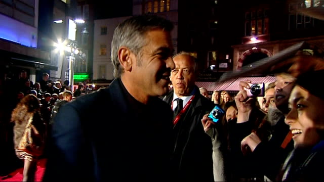 George Clooney attends premiere of 'The Ides of March' More of Clooney signing autographs for fans / Clooney posing on red carpet for press...