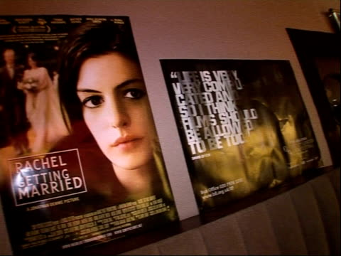 interviews with jonathan demme, anne hathaway, gwyneth paltrow; england: london: int general view of 'rachel getting married' film posters in foyer /... - アラン・リックマン点の映像素材/bロール