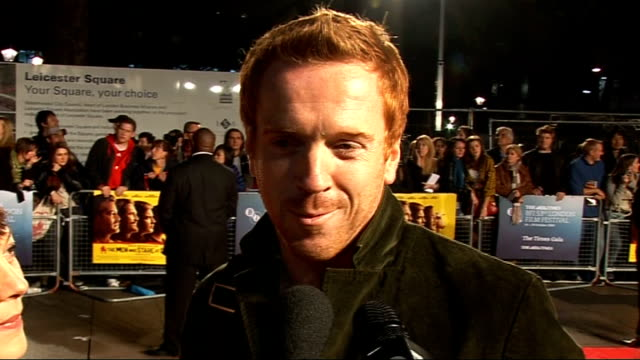 'men who stare at goats' premiere: arrivals; damian lewis interview alongside wife helen mccrory on red carpet sot - on starring in the misanthrope... - ヘレン マックローリー点の映像素材/bロール