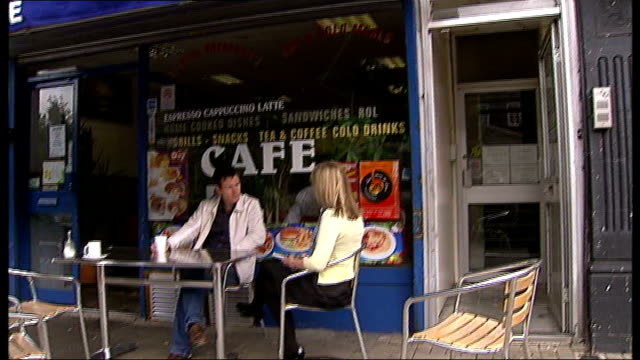 'telstar' film holloway road nick moran interview sot as sitting outside greasy spoon cafe and plaque marking home and studio of joe meek - telstar stock-videos und b-roll-filmmaterial